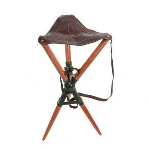 Silla trípode giratoria con asiento en piel de bovino y patas en madera de haya